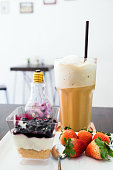 Cappuccino coffee blueberry dessert and strawberry