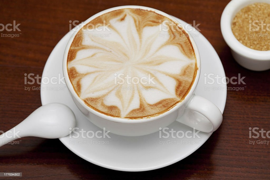 cappuccino, coffee cup and cane sugar royalty-free stock photo