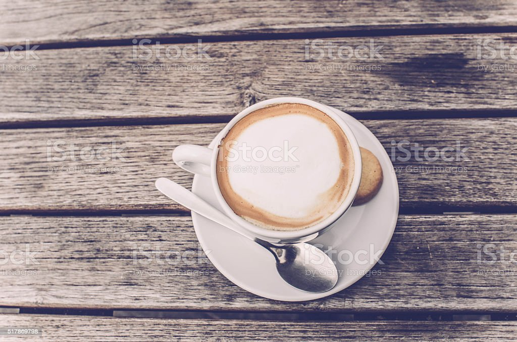 Cappuccino Coffee cup top view on wooden table background, Italy stock photo