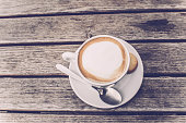 Cappuccino Coffee cup top view on wooden table background, Italy