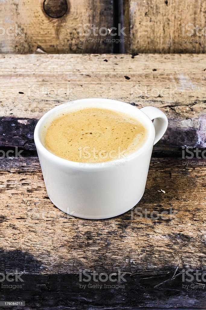 Cappuccino coffee cup with foam on white saucer royalty-free stock photo