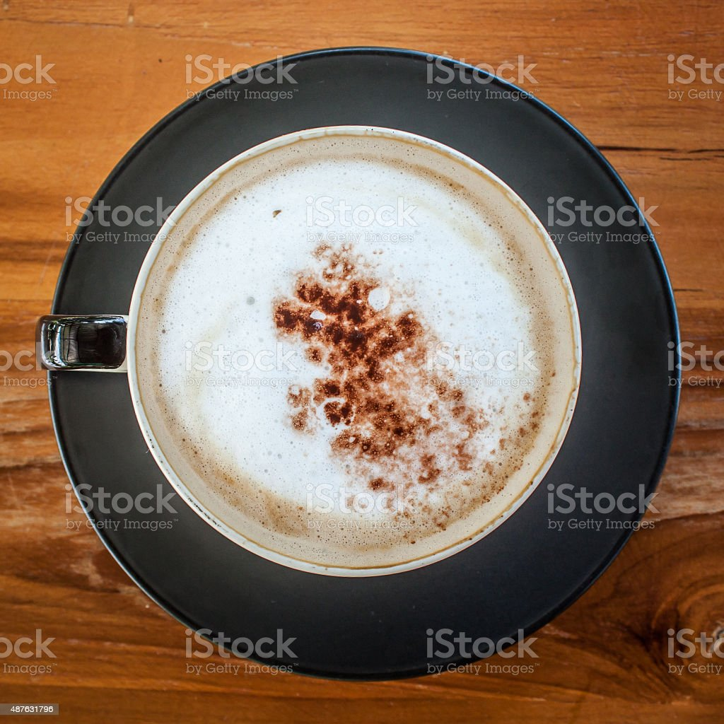 cappuccino coffee on wood table stock photo