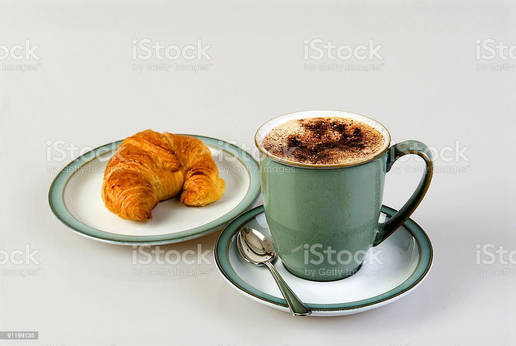 Cappuccino coffee with criossant for breakfast royalty-free stock photo