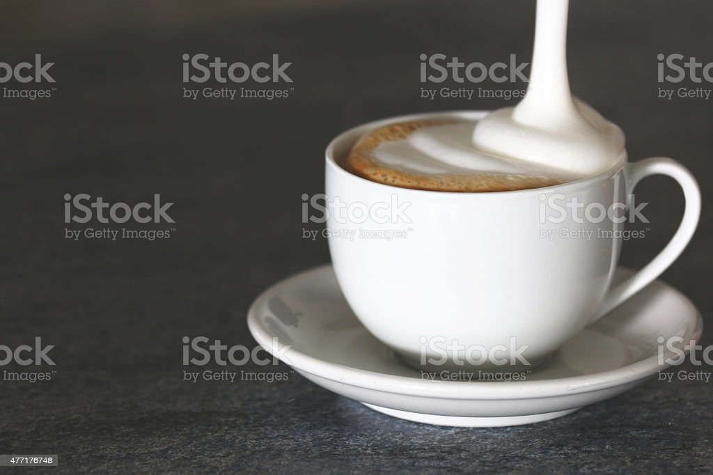 Cappuccino cup on a gray background stock photo