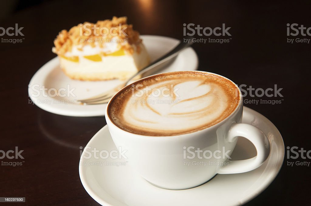 cappuccino cup with cake royalty-free stock photo
