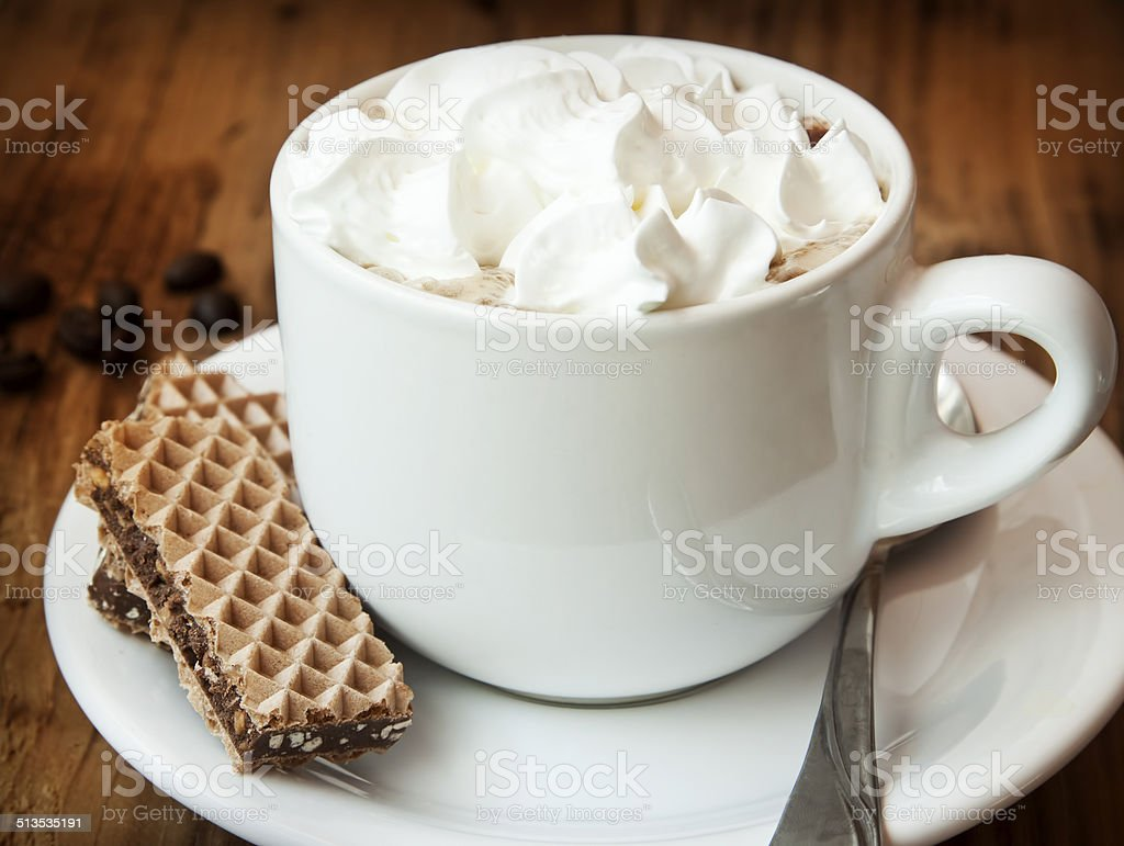 Cappuccino Cup with Cream and Cookies stock photo