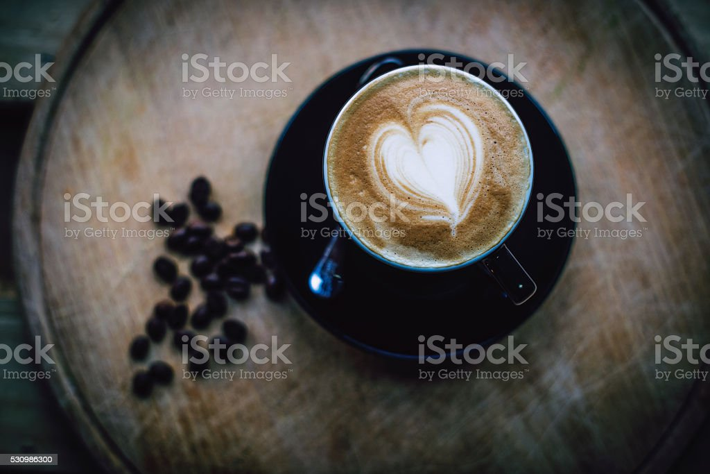 Cappuccino cup with drawing on foam stock photo