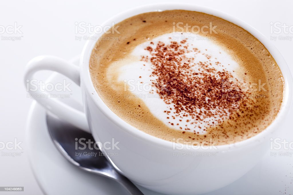 A cappuccino in a white cup on a white background royalty-free stock photo