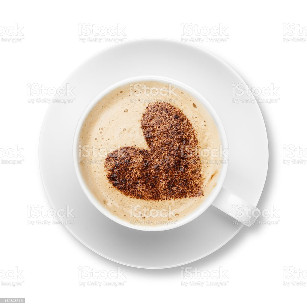 Cappuccino in white cup and saucer with chocolate heart stock photo