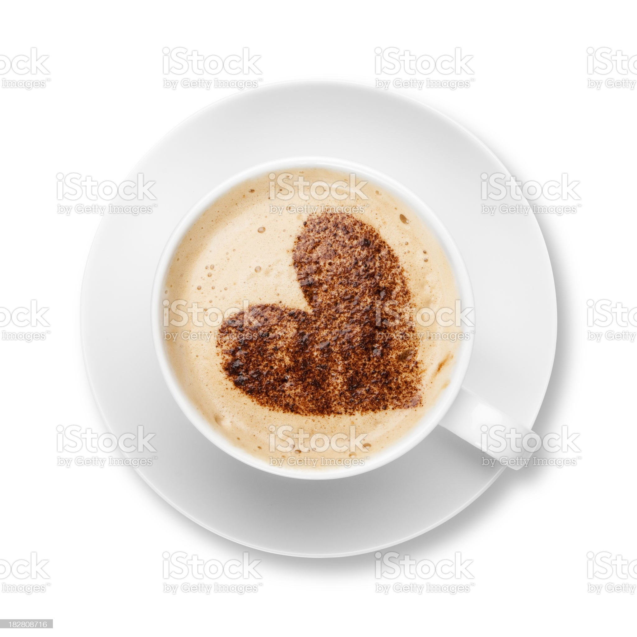 Cappuccino in white cup and saucer with chocolate heart royalty-free stock photo