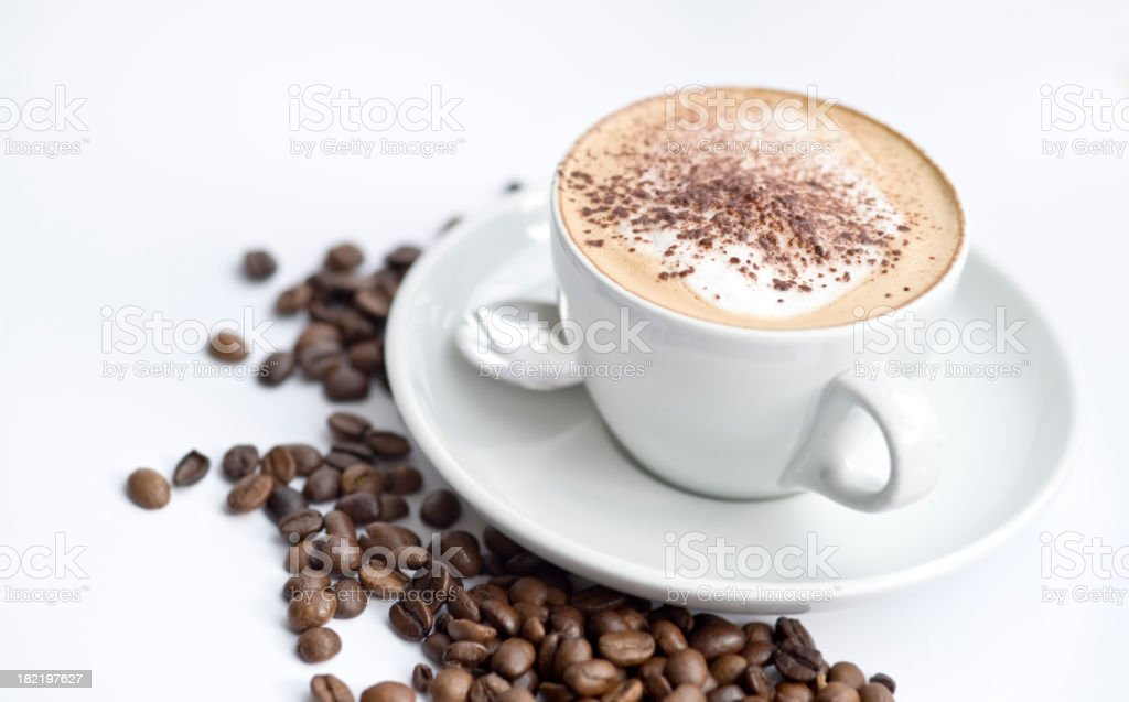 Cappuccino in white cup with coffee beans stock photo