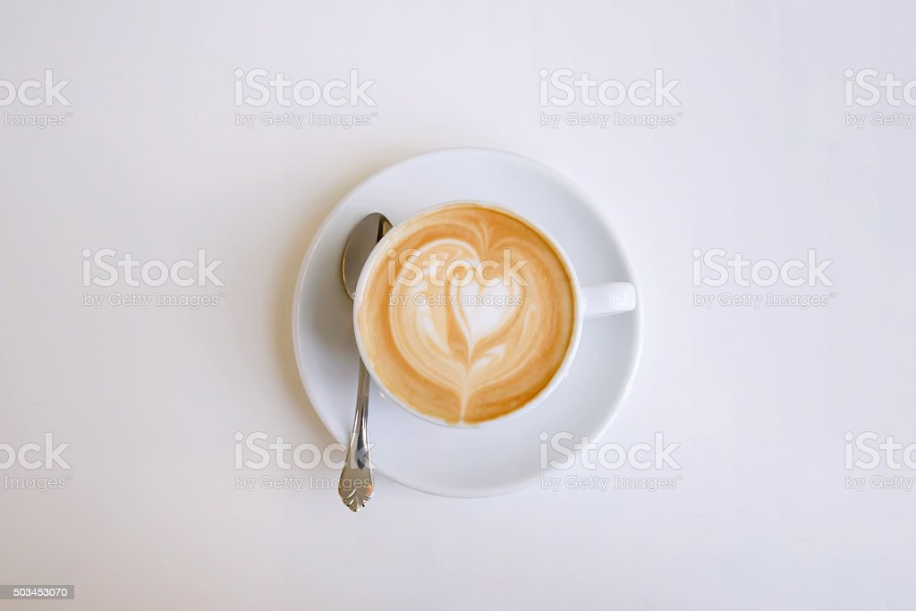 Cappuccino mug with a heart stock photo