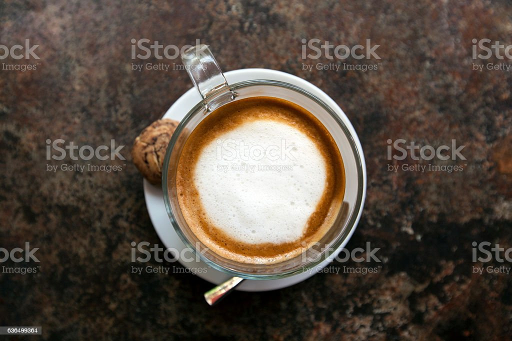 cappuccino on a rusted metal table stock photo