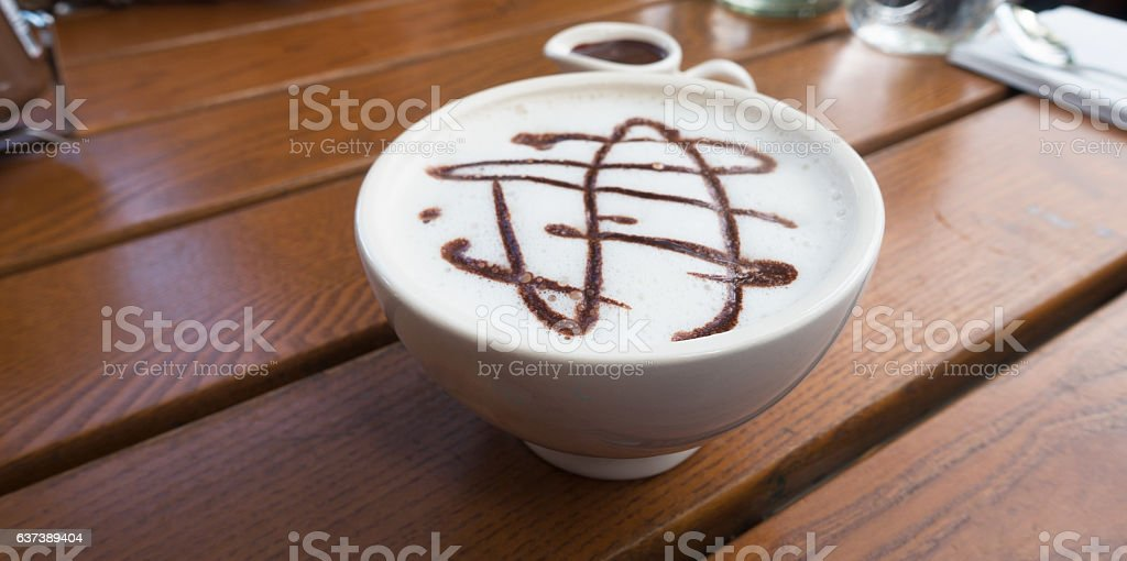 Cappuccino on Wooden Plank Table stock photo
