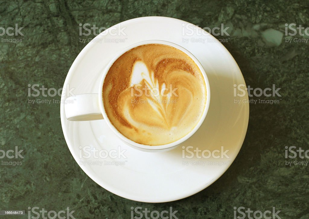 Cappuccino or latte coffee on table royalty-free stock photo