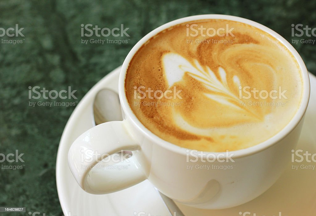 Cappuccino or latte coffee with spoon royalty-free stock photo
