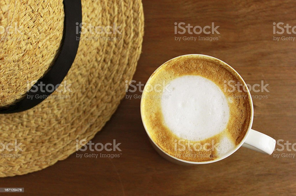 Cappuccino or latte coffee with straw hat royalty-free stock photo