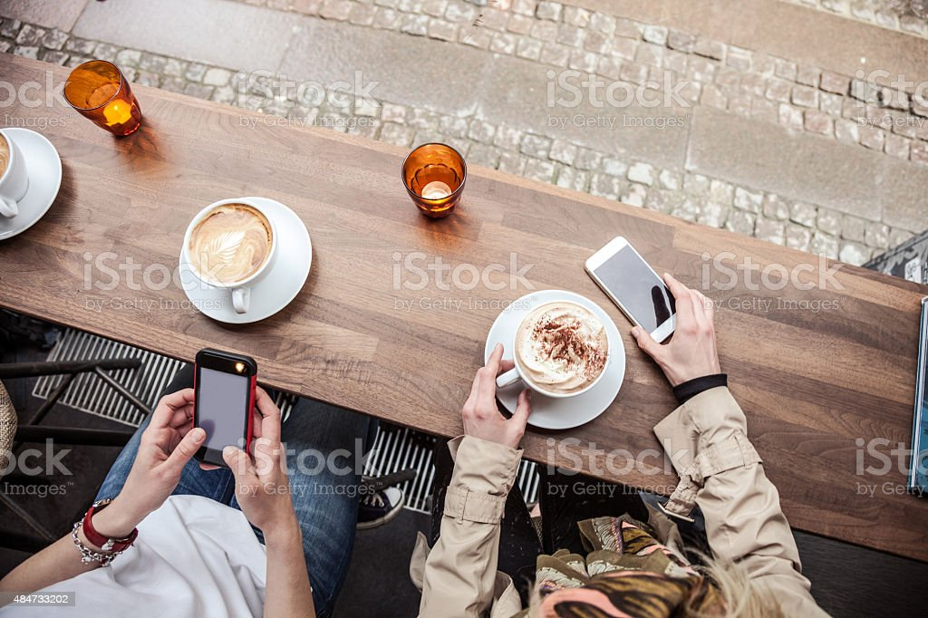 Cappuccino served on a cafe table in Copenhagen - Denmark stock photo