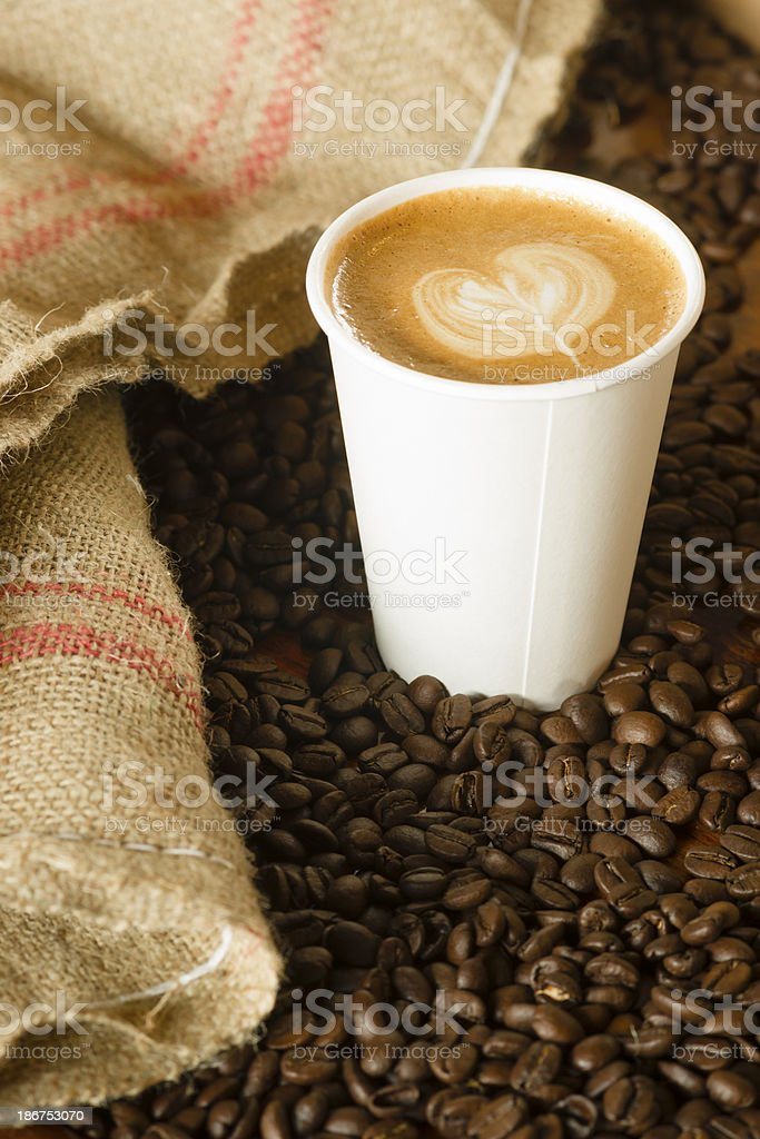 Cappuccino To Go Paper Cup Burlap Bag Roasted Coffee Beans stock photo