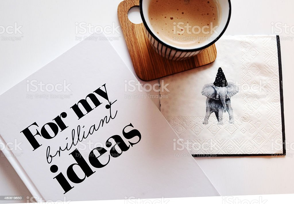 Cappuccino with a note book in the early morning stock photo