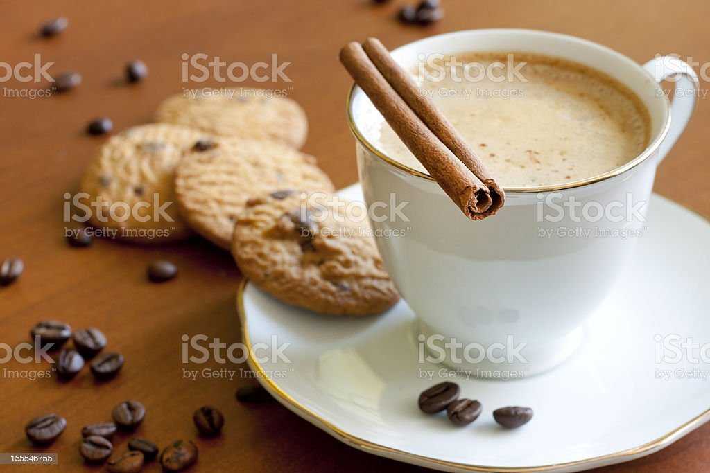 Cappuccino with chocolate cookies on wooden table royalty-free stock photo