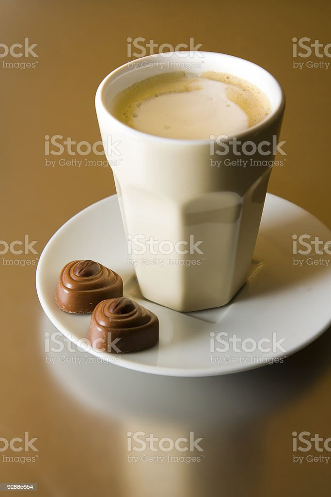 Cappuccino with chocolates royalty-free stock photo