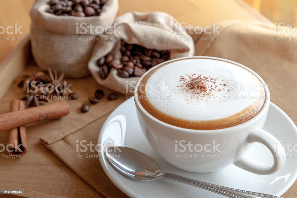 cappuccino with coffee beans stock photo