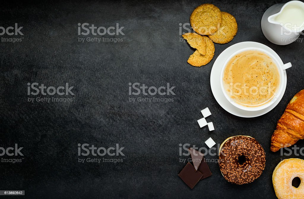 Cappuccino with Croissant and Donut on Copy Space stock photo