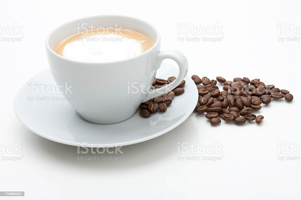 Cappuccino with fresh coffee beans in white background royalty-free stock photo