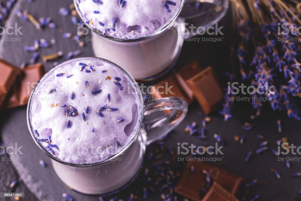 Cappuccino with lavender and chocolate syrup and flowers stock photo