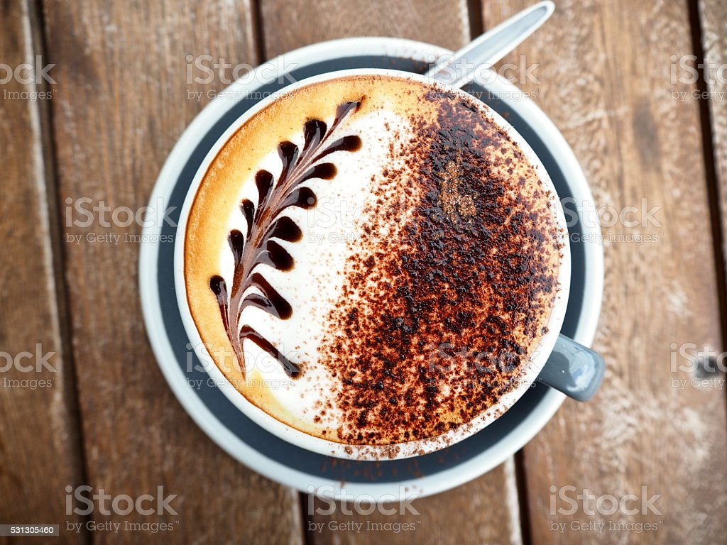 Cappuccino with silver fern latte art 2 stock photo