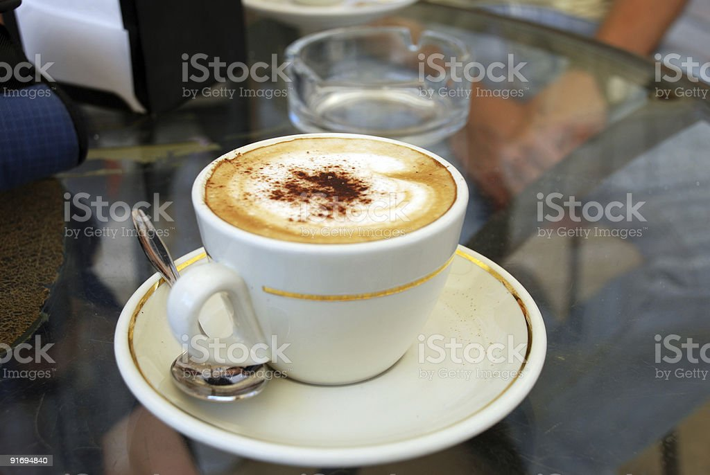 Cappucino at an Outdoor Cafe royalty-free stock photo