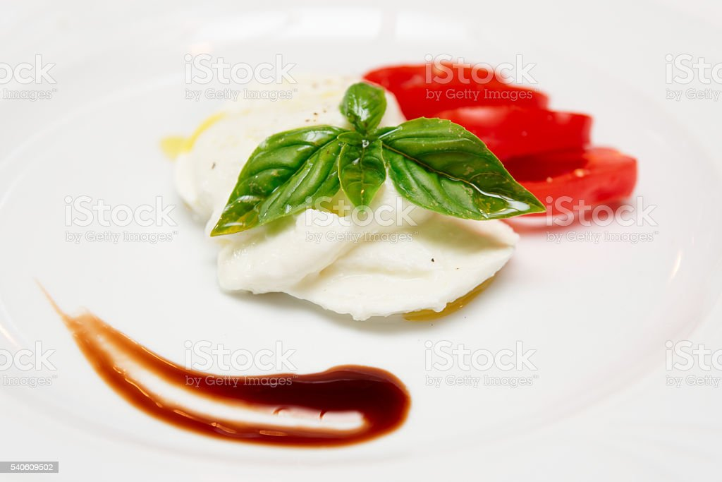 Caprese appetizer on plate stock photo