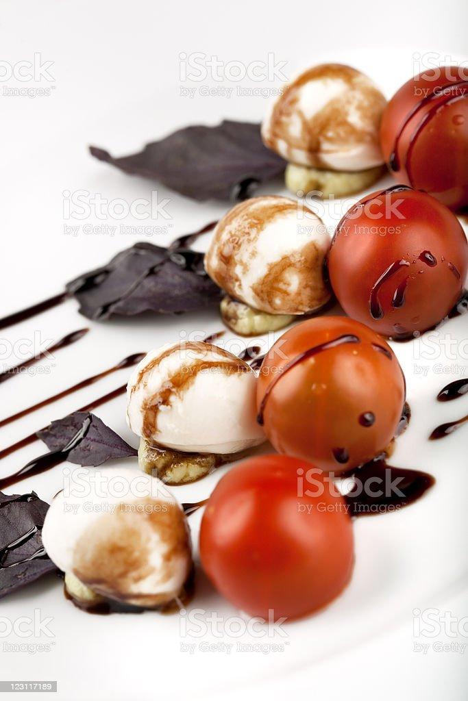 Caprese salad - Cherry Tomato, mozzarella and avocado mousse royalty-free stock photo