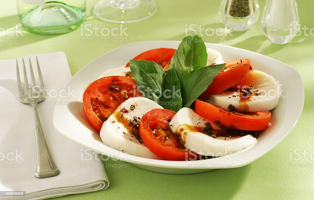 Caprese Salad made of mozzarella, tomatoes and basil stock photo