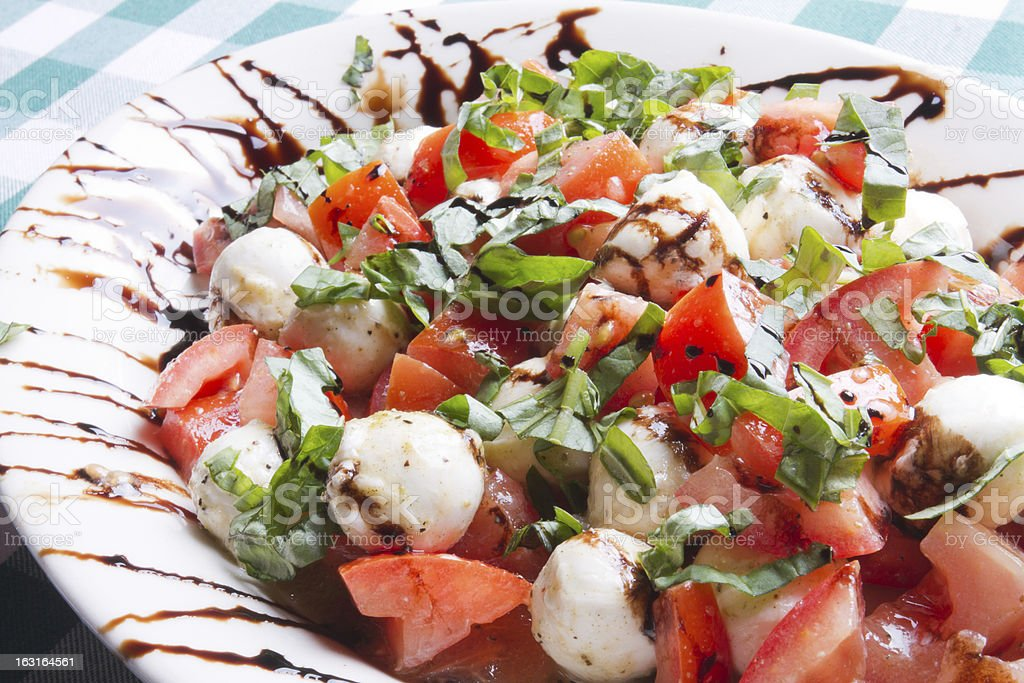 Caprese Salad on Gingham royalty-free stock photo