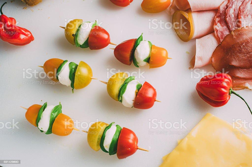 Caprese salad on sticks stock photo