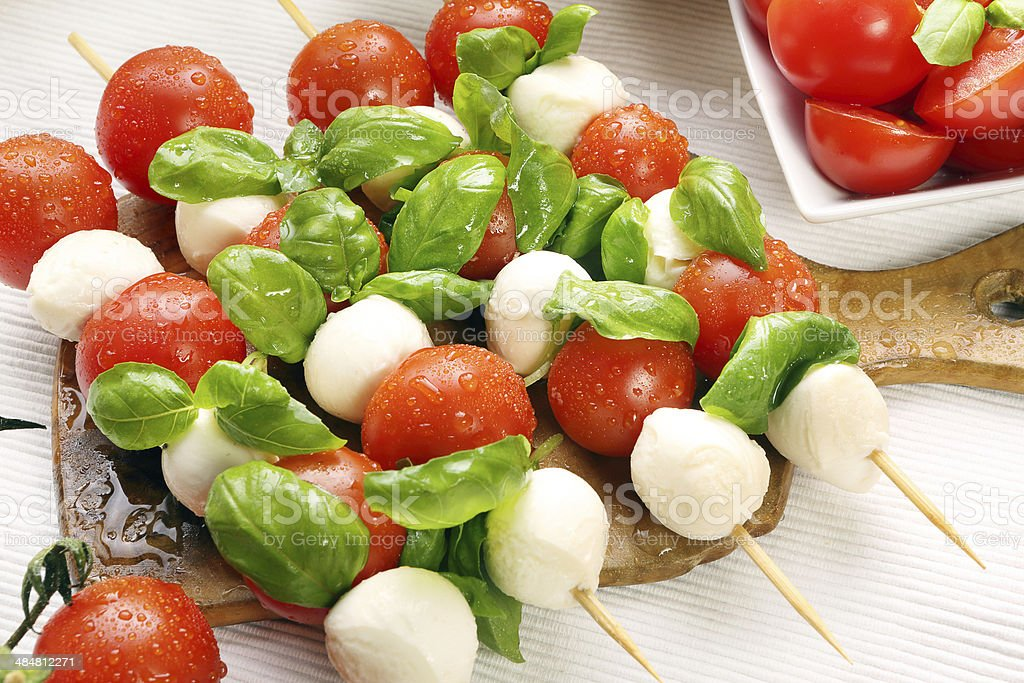 Caprese salad. Skewers with tomato and mozzarella stock photo