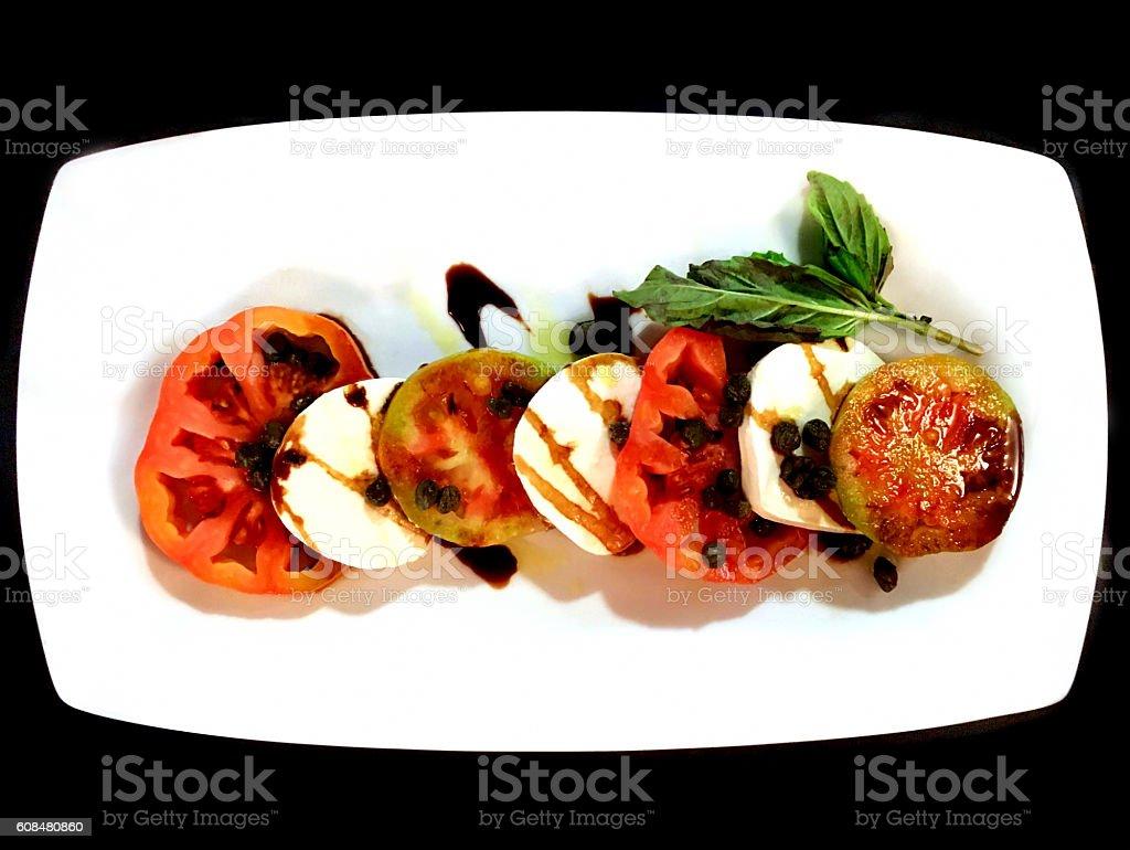 Caprese salad with heirloom tomatoes stock photo