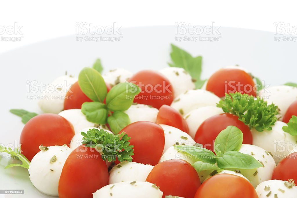 Caprese salad with mozzarella and cherry tomato royalty-free stock photo