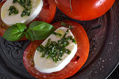 Caprese salad with mozzarella cheese, tomatoes and basil