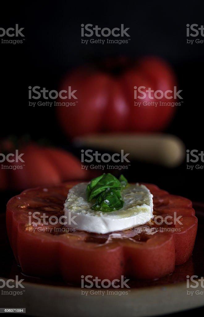 Caprese salad with mozzarella cheese, tomatoes and basil stock photo