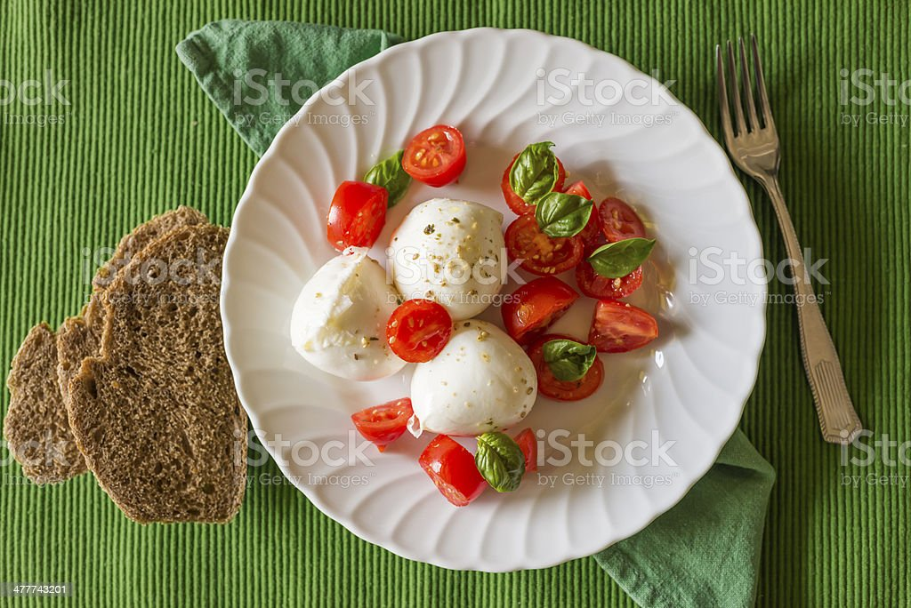 Caprese Salad with Mozzarella Cheese Tomatoes Basil and Wholewheat Bread royalty-free stock photo