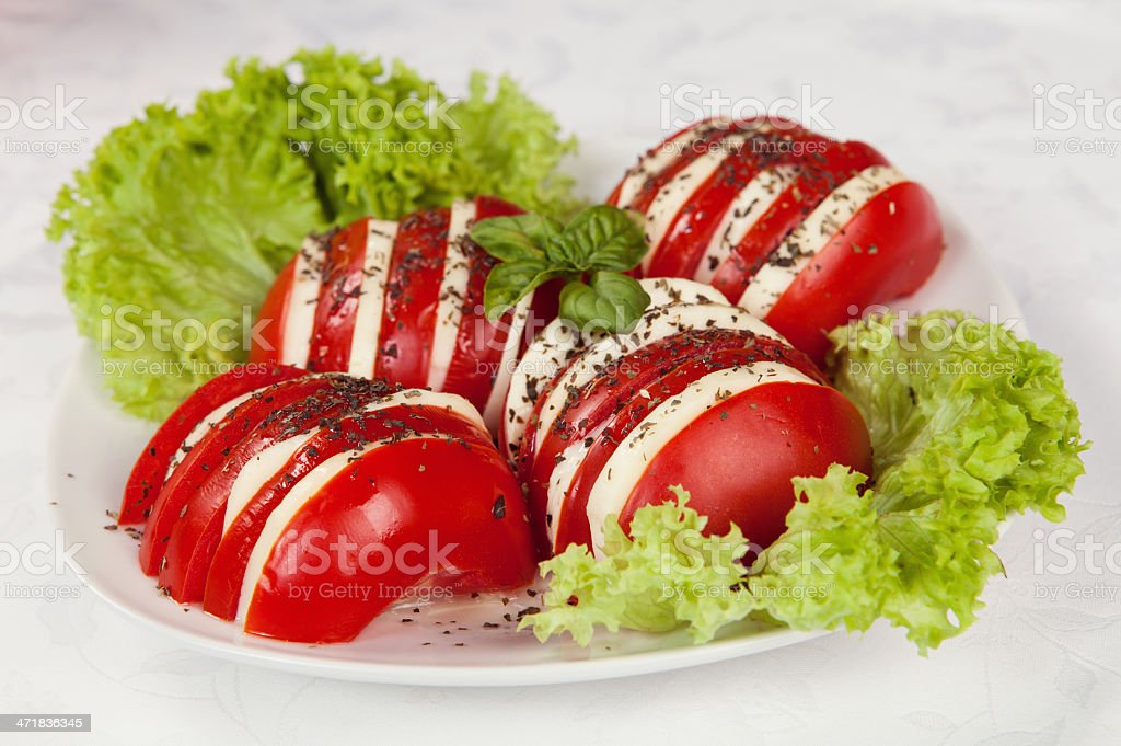 Caprese salad with mozzarella, tomato, basil and balsamic vinega stock photo