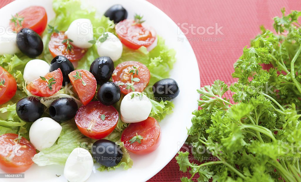 Caprese salad with tomato, olives and mozzarella royalty-free stock photo