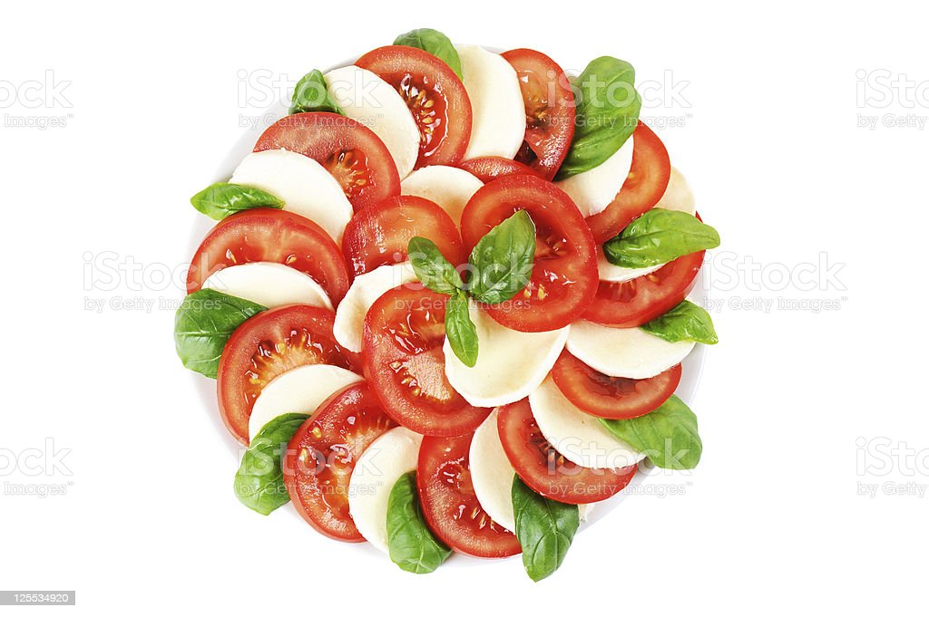Caprese - Tomato Mozzarella Salad with Basil stock photo
