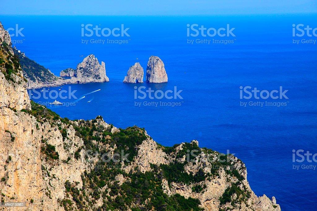 Capri above Mediterranean sea, faraglioni and ships – Amalfi Coast, Italy stock photo