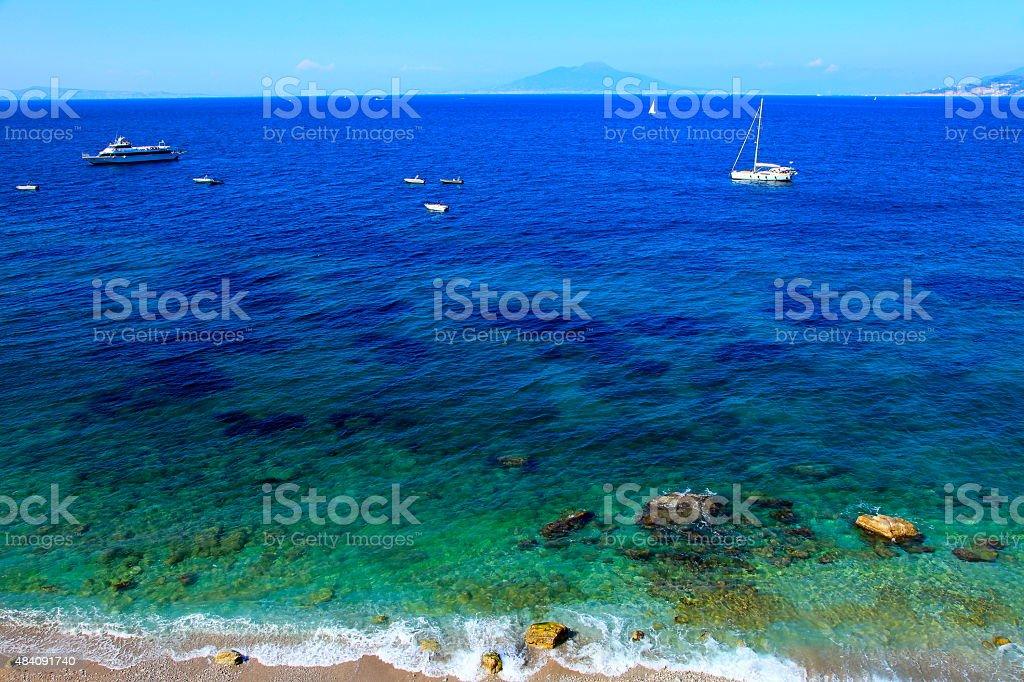 Capri beach, boats, yatch, blue mediterranean sea, Amalfi coast stock photo