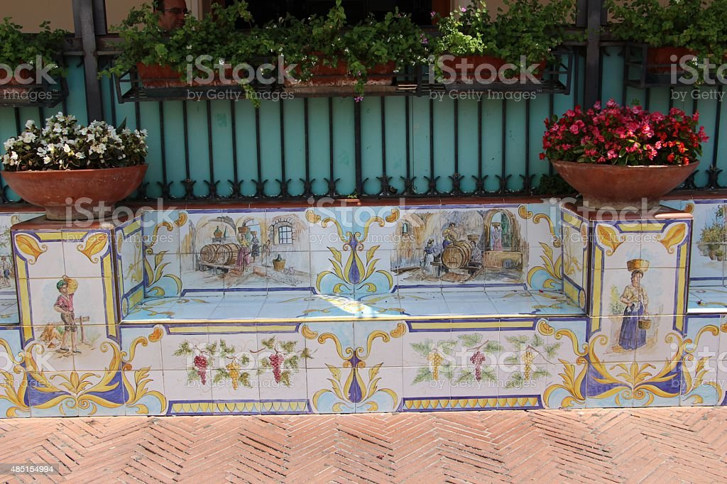 capri - colorful bench in the old town stock photo