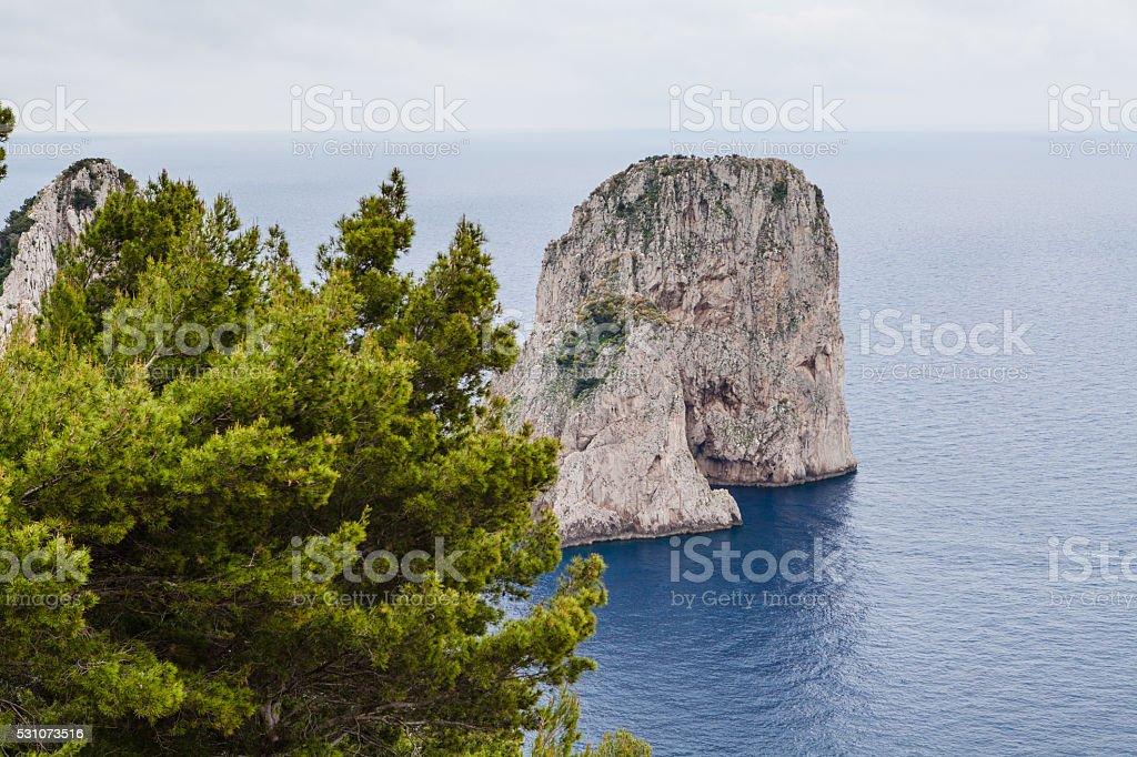 Capri, view of Faraglioni, clouds stock photo
